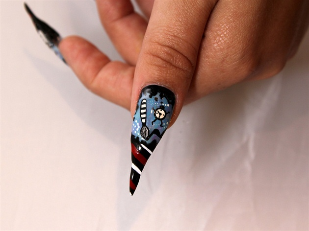 Last, I added stripes to the thumb, and the drip effect along the top of the nail. The clock and finishing details were also added with acrylic paint.