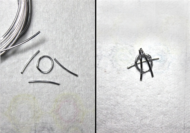 The anarchy symbol is created by cutting and bending wire, then gluing together.