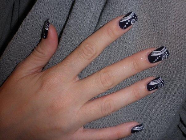 beautiful black nail with white decorati