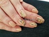Yellow-orange flowers on nude nails
