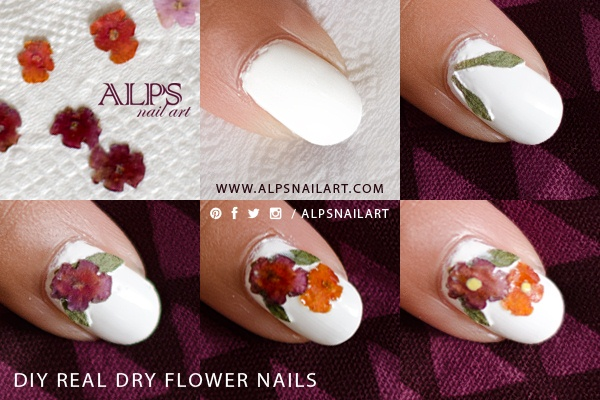 Paint the base nail polish. Once its semi dry, start placing dried real leaves and flowers. Add the dot in the center using a dotting tool. Seal the flower nail art design with a Top Coat.