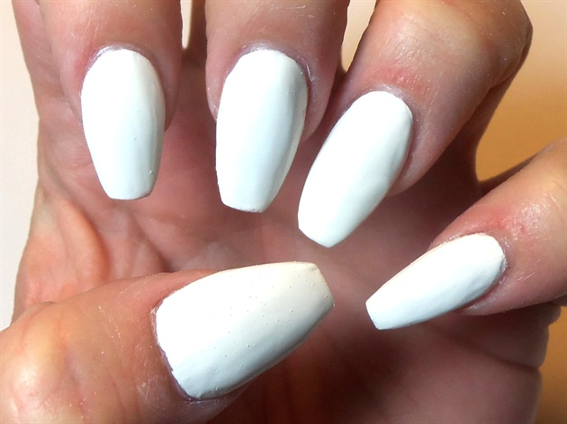 First, I began with a white base of traditional nail polish.
