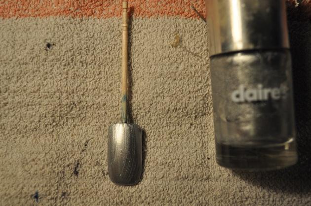 Paint your nails silver nail polish.