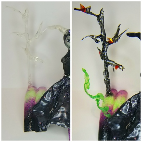 Create your spooky tree by attaching a small straw to your nail with hardgel. Sculpt your spooky branches by applying a bead of hardgel to an area  on the tree, tip the tree sideways  and allow the hardgel to flow downwards towards your table, as the gravity pulls the gel downwards cure by taking your lamp off the table and curing in mid air.  Repeat these steps until you have reached your desired number of branches. Complete your core of the tree by swirling hardgel around the entire tree, this will create texture. HAND PAINT  your detailing onto the tree with white and greys to accent the texture of the tree. Finish by using your Swarovski crystal teardrops attached in clusters of 2 to represent leaves.