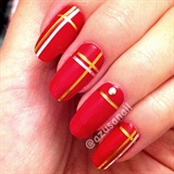 red nails with gold tape
