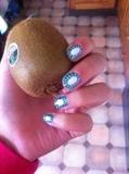 Kiwi Nails, holding a kiwi... whoopee...