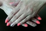 Hot orange almond nails.