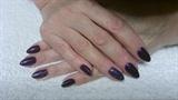 Dark almond nails.