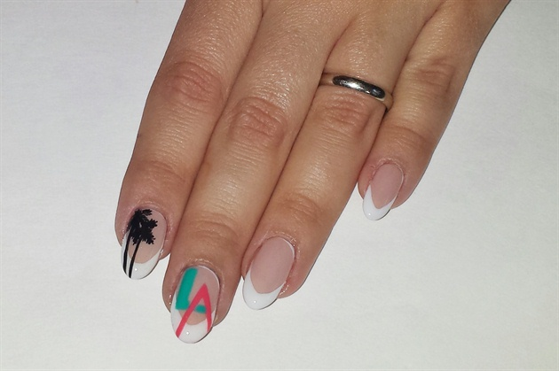 On the left hand, use black acrylic paint to paint two long lines for the trunks of the palms on the index finger. Using a small brush and short strokes, create 5 long