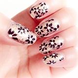 Glitter black flower nail polish