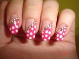 Pink manicure with white dots, diamonds