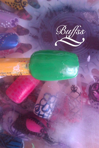 Start by putting base coat on your nails and painting the whole nail green. I didn't have the right color so I used the one I had.