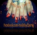 Orange crackle polish on black onyx