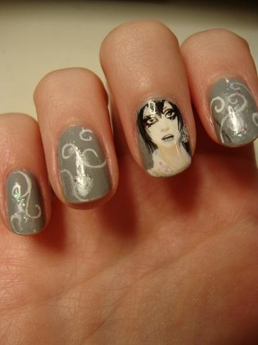 Tiny girl on a tiny nail