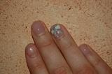 white ribbon on natural nails