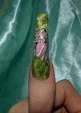 T Rex nail art.