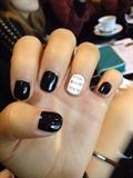 Black newspaper nails