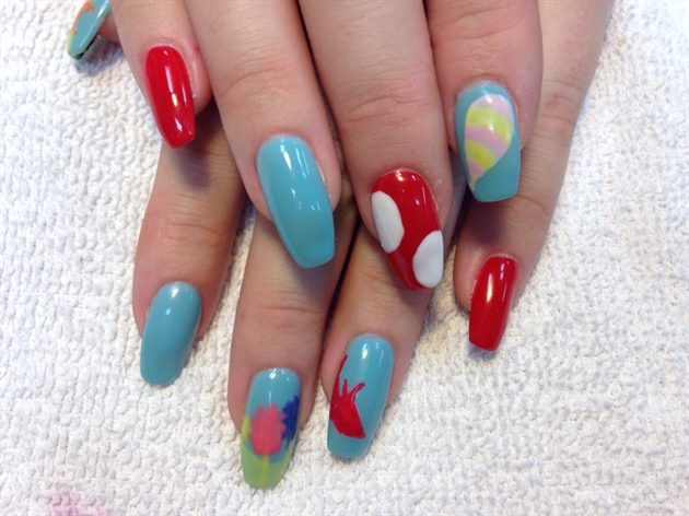 I painted the base colours red and blue with gel polish then painted the shapes I needed for the different designs.
