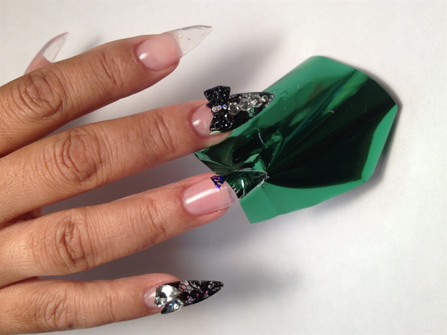 Apply your 3D art Jewels by adding a dot of gel or acrylic set jewel and place under lamp light for 2min. add a little nail glue allow to dry 1 min. on other nails Paint ciate' fix foil glue allow to dry clear,then began to place your metallic foil in desired places to create your design.