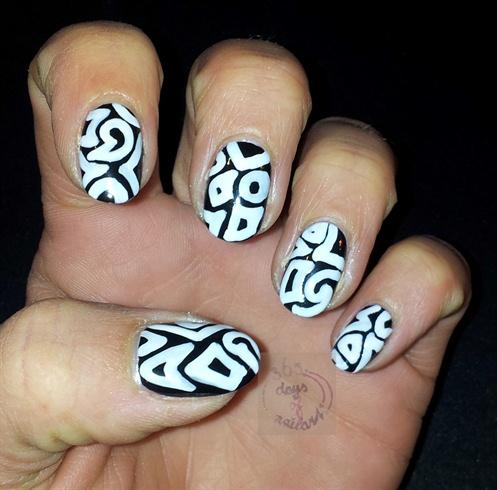 Use a brush and white nail polish to make any shapes you like. Don't make them too thin