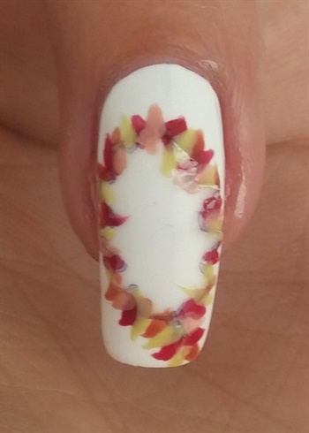 Get your polishes and the nail art brush.\nPaint small fall leaves around the outline of your sticker.\n\nWait for it to completely dry!!!\n