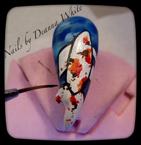 When coloured paint is dry outline the fish in black tack free gel polish, using a small paint brush. Flash Cure.