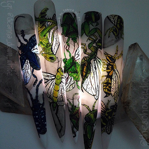 I get a little more creative and play with my design a bit trying to better capture the details in the wings because they are hard hard to see in the photos. I added a small light behind my nails and dimmed the lights. Tada! Glow bugs!