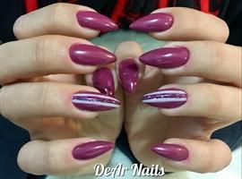 Stiletto Nails With Stripes