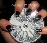 glitter bow on black nails