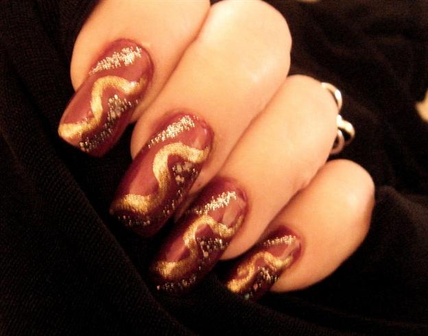 Burgundy with gold swirl