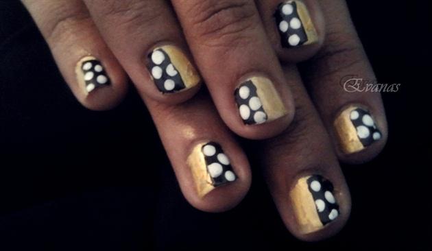 Polka dots on gold nails