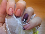 Purple manicure with white flowers