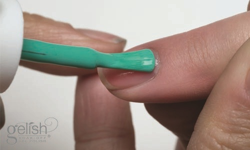 """Apply a thin coat of Gelish® Soak-Off Gel Polish in """"Garden Teal Party"""" to the entire nail, capping free edge.  Cure nails in an 18G LED light for 30 seconds or a UV light for 2 minutes.  Repeat Step 5 for a second coat."""