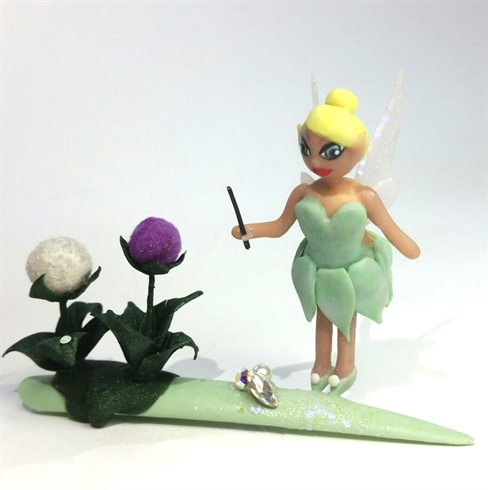 I attached all the pieces and Swarovski to the tip, added some glitter acrylic under Tinkerbell, and secured her feet.