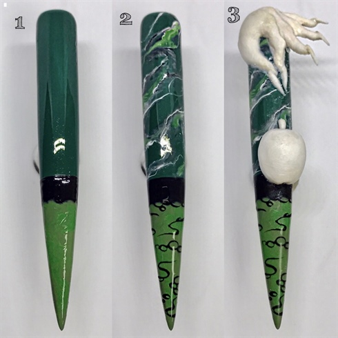 [7] Look! Understand, the symbol that lies within.\n1. Begin with two coats of forest green, curing between each coat. Paint one third of the nail with a mixture of different light greens. Create the rim of the cauldron. Cure.\n2. Marble the top portion of the nail. Add bubbles and lines in the cauldron. Cure.\n3. Directly onto the nail, sculpt an apple and the Evil Witch's hand.\t