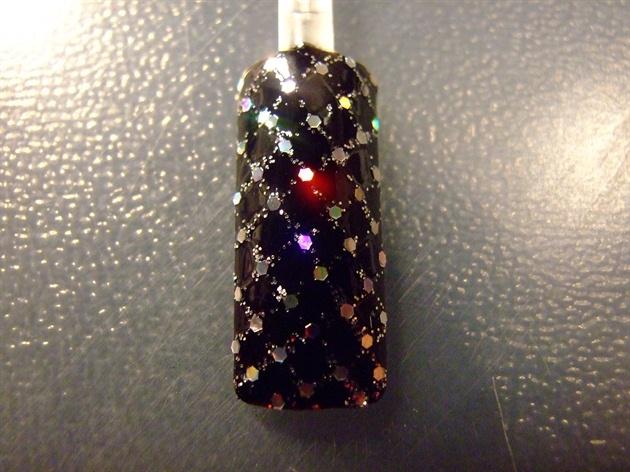 Glittery criss cross nail art design