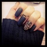 Black nail polish with gem