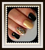 Black, gold and animal nail art