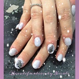 Lilac Gel Nails With Feather Art