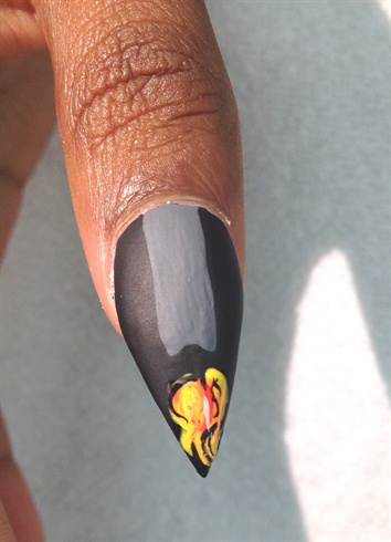 With acrylic paint paint a candle on the thumb. apply matte gel coat to entire thumb then add clear builder gel over flame to make it appear a bit 3d.