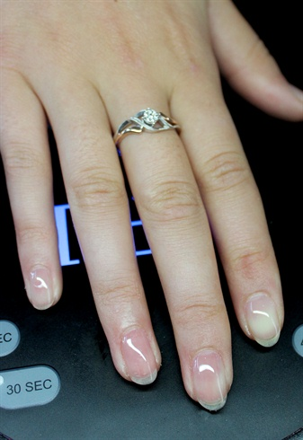 Apply base coat to all nails and cure in LED light.