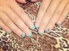 Blue Gel Nails With Buckmark