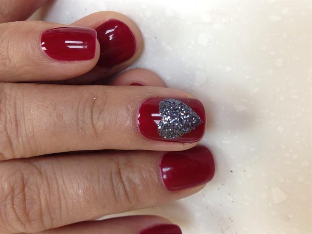 Black glitter heart on red gel polish