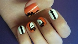 Orange clockwork nails