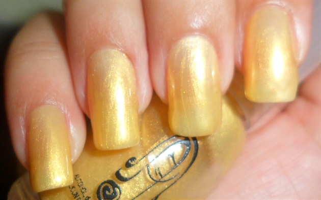Apply base coat then paint your nails gold