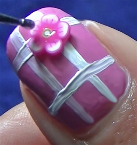 Add a fimo flower per nail