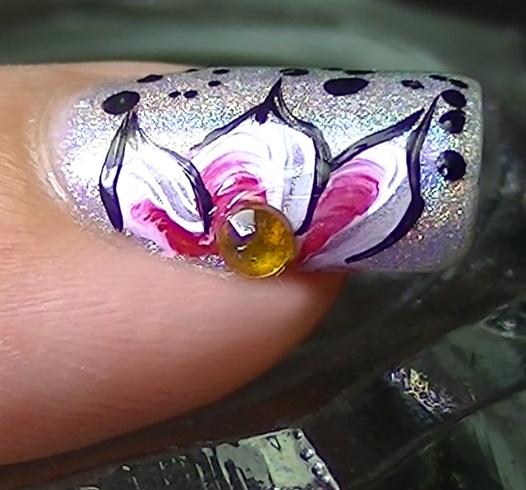 Apply a round orange rhinestone in the flower's center
