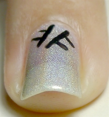 With black acrylic paint and a fine nail art brush, start creating the weave effect