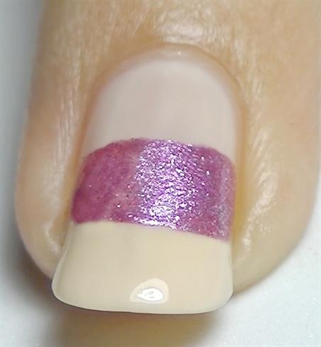 Add a pink metallic nail polish horizontally