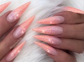 Coral Glitter Ombré Stiletto Nails
